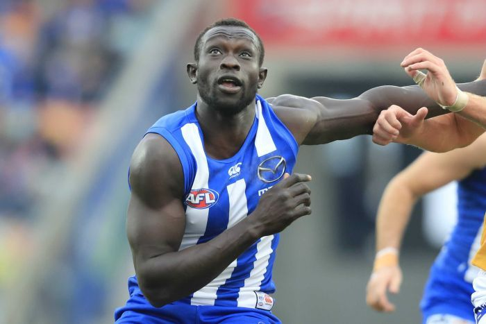 Majak Daw eyes the ball while on the field.