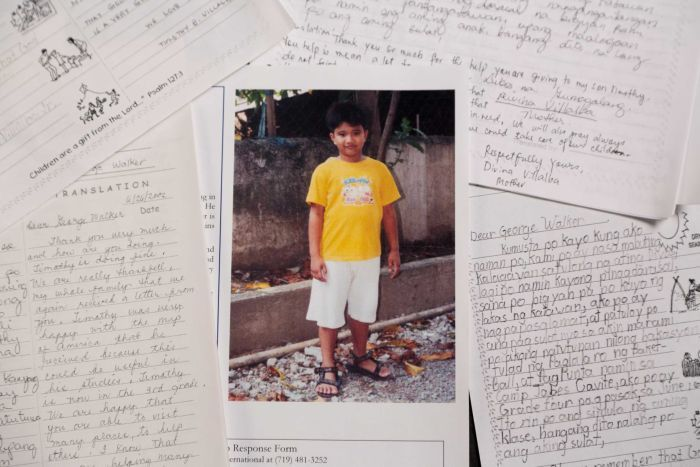 A photo of Timothy surrounded by his handwritten letters from George HW Bush.