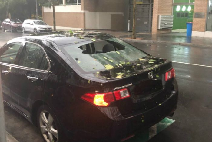 A car with a smashed back window