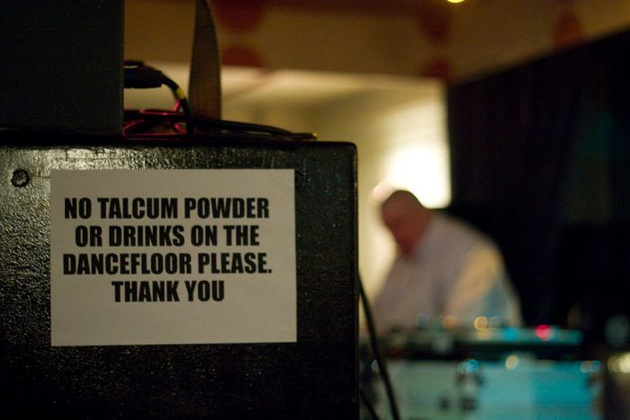 A sign reads 'no talcum powder on the dance floor'