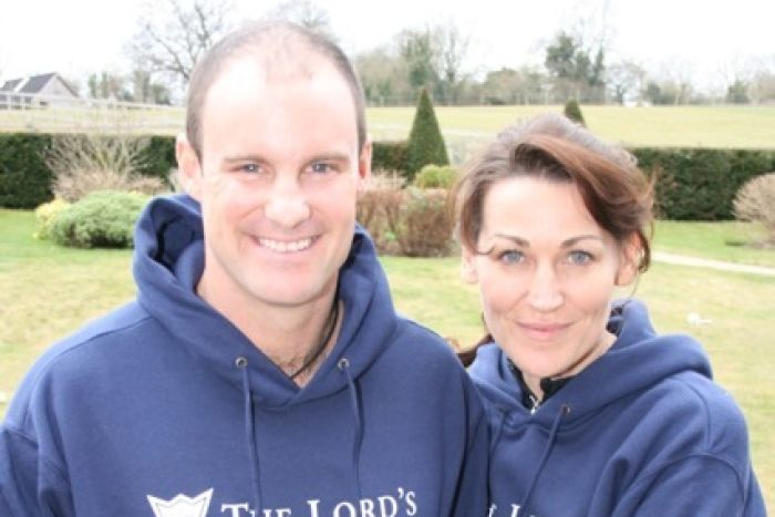 Andrew Strauss and wife Ruth stand arm in arm on a green lawn.