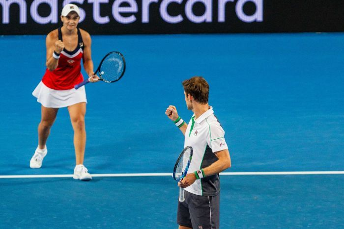 Australia's Ash Barty (top) and Matt Ebden celebrate a point in their Hopman Cup tie against Spain.
