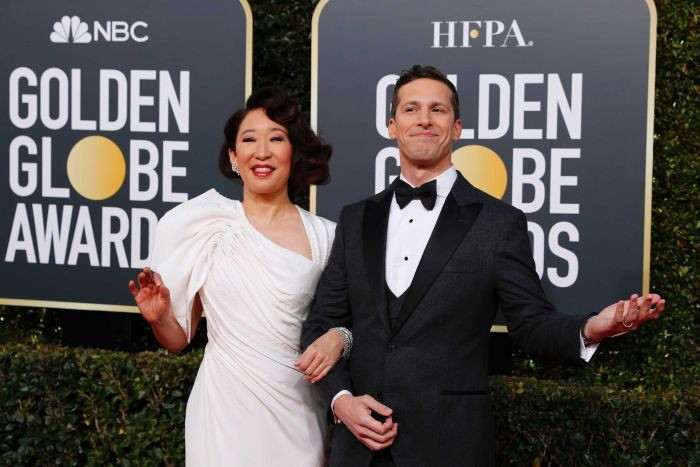 Sandra Oh and Andy Samberg arrive on the Golden Globes red carpet in Beverly Hills, California.