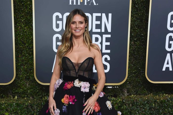 Heidi Klum wearing a floral dress on the red carpet.