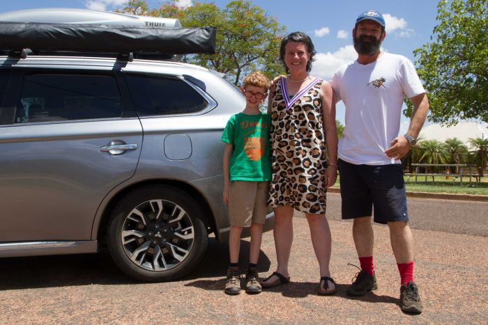 Siobhan Toohill standing with her family in front of the Windorah Pub in south-west Queensland