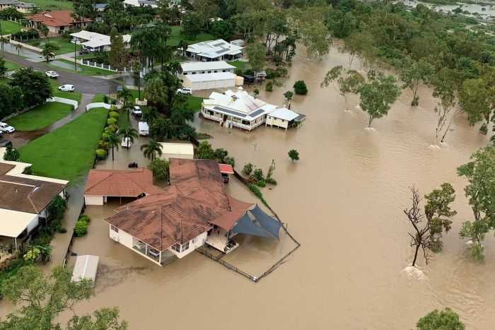 Floodwaters surrounding some homes, as seen from the air