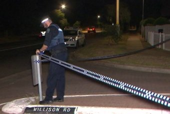A police officer cordons off Willison Road.