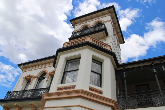 An external shot of Prospect House shows the heritage building's windows and balcony.