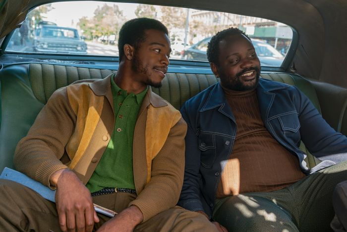Colour still of Stephan James and Brian Tyree Henry sitting in backseat of car in 2018 film If Beale Street Could Talk.