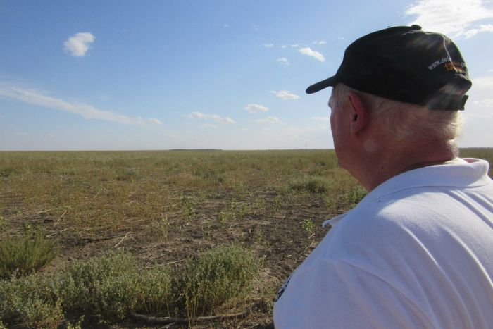 Mark Hutton stands in a dry Lake Menindee.