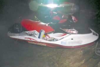 A jet ski sit on the shore