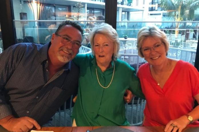 Kim Dahler at a table with his brother and his mother.