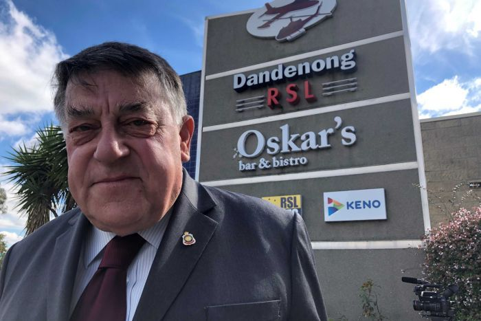 John Wells, President of the Dandenong RSL, standing in front of the RSL sign