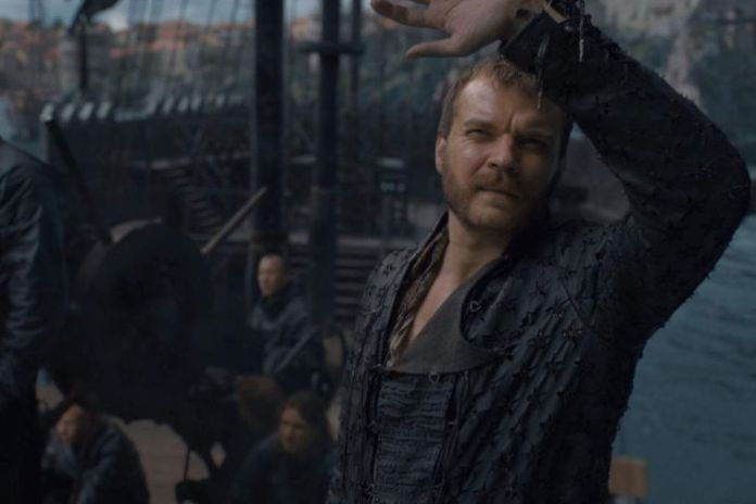 Euron looks at something in the sky.