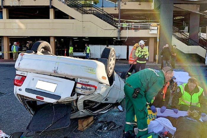 A Ford Festiva crashes through the barrier of a first floor car park at Westfield Marion in Adelaide