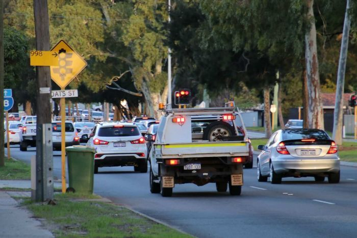 Traffic stopping at a set of lights on Orrong Road.