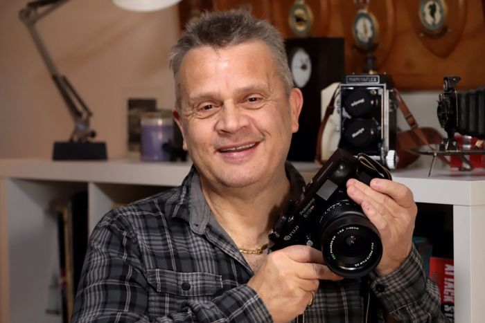 Roger Arnaud holds a camera