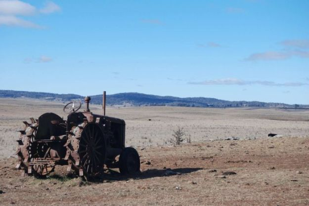 Tractor on drought-ravaged farm in Guyra, NSW.