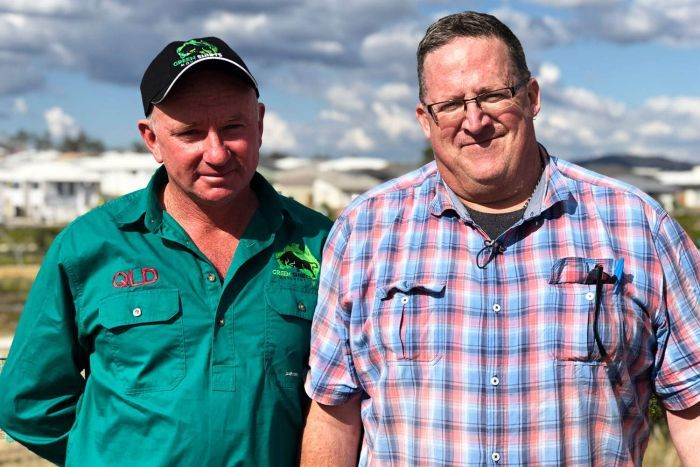 Farmer Jim Willmott and Biosecurity Queensland worker Jaimie Varcoe at a housing estate.
