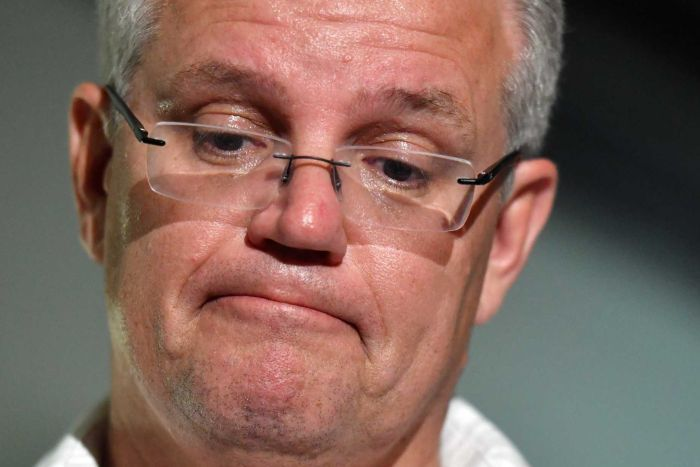 A close up of Scott Morrison looking down during a press conference