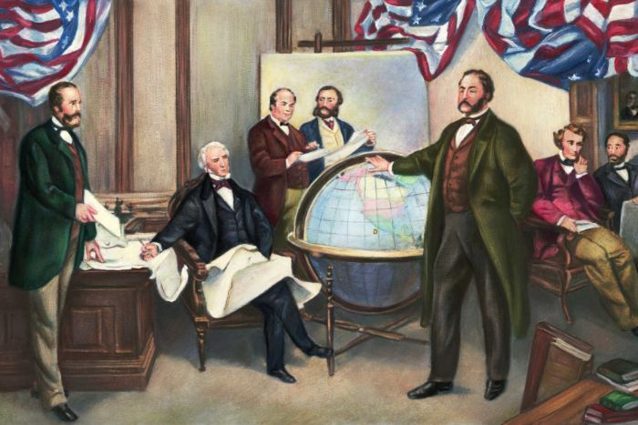 A nineteenth-century colour painting of seven men gathered around a large world globe and US flags.