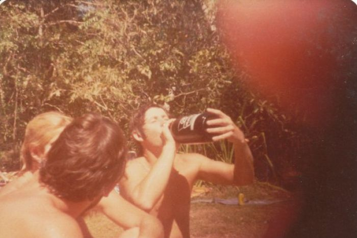 Dated photograph, circa 1971, young boy drinking Darwin Stubby.