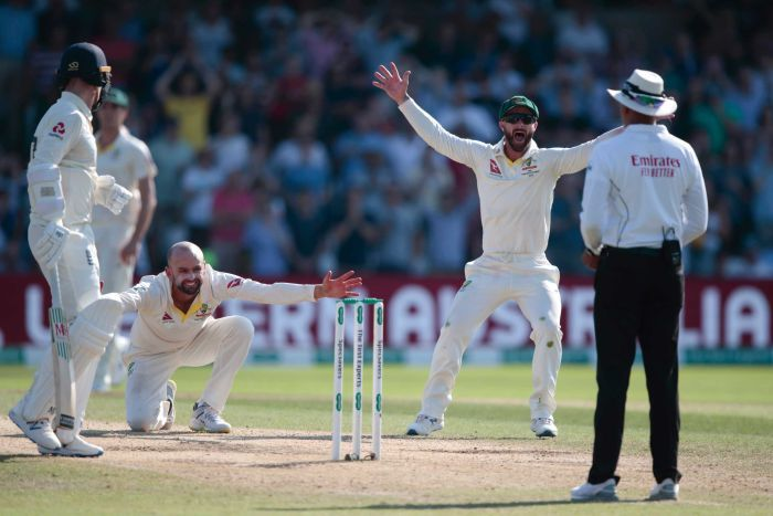 Lyon is on one knee with his arms outspread. Wade stands next to him with his arms raised. The umpire is unmoved.