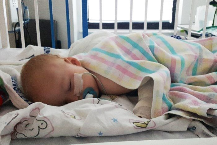 14-month-old Thomas Skrypinski lying down in hospital asleep.