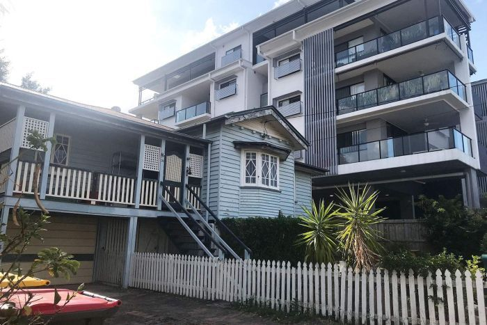 A Queenslander house beside a new apartment building at Lutwyche on Brisbane's northside.