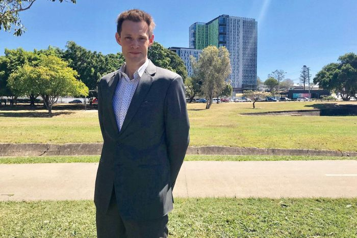 Dr Tony Matthews stands outside near the Park Central student accommodation buildings at Buranda in Brisbane.