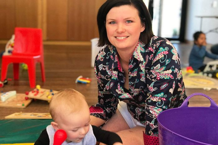 Talitha Vuillemot and her son Ourson play on the floor at playgroup at Fitzgibbon Chase's Community Centre.