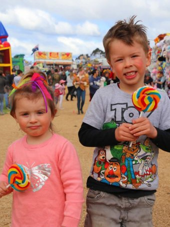 Two children with lollipops.