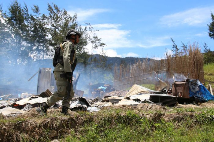 A security officer patrols following a riot in Ilaga, Puncak regency in Papua, Indonesia.