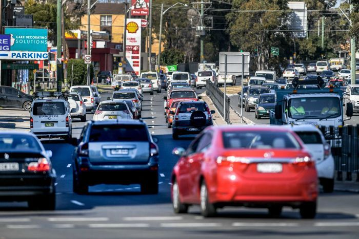 Three lanes of cars in traffic shot from behind on the Hume Highway in Liverpool, NSW.