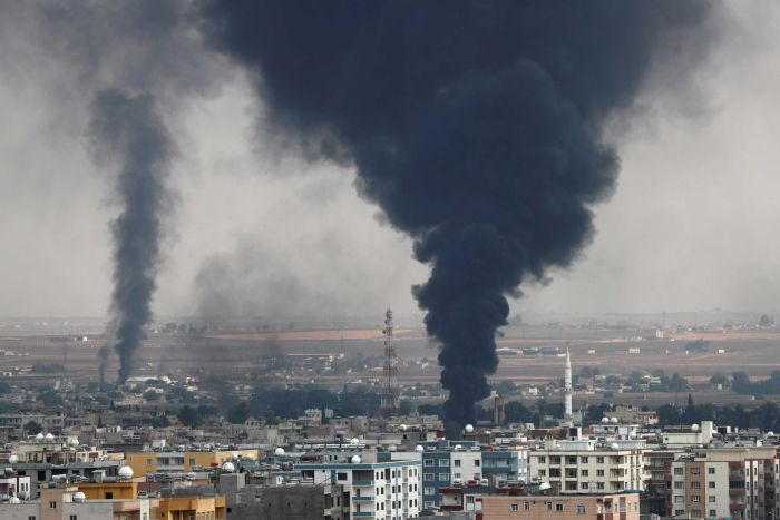 Smoke rises over the Syrian town of Ras al Ain.
