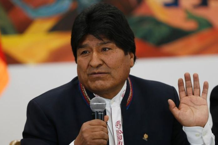 The President of Bolivia, Evo Morales, expressing himself in a microphone.