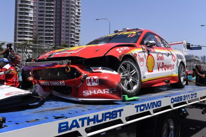A Mustang emblazoned with Shell sponsorships and sporting a smashed-up bumper sits on a flatbed truck.