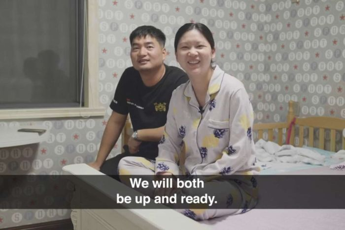 """A couple sits on a bed. Subtitle reads """"we will both be up and ready""""."""