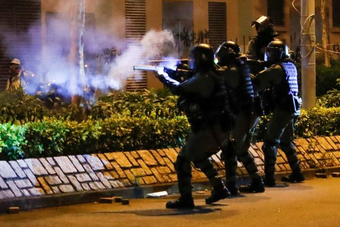 Hong Kong police fire gas rounds at protesters.