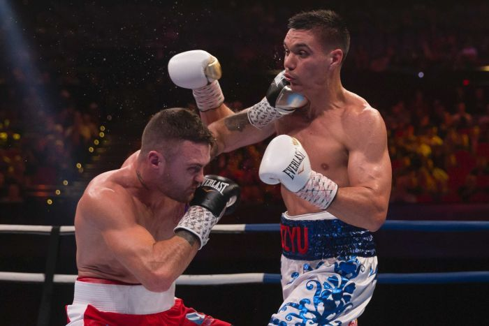 Two boxers swap punches during a title fight in Sydney.