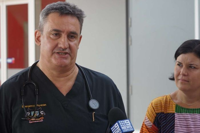 Dr Didier Palmer in scrubs talks outside Royal Darwin Hospital at a press conference