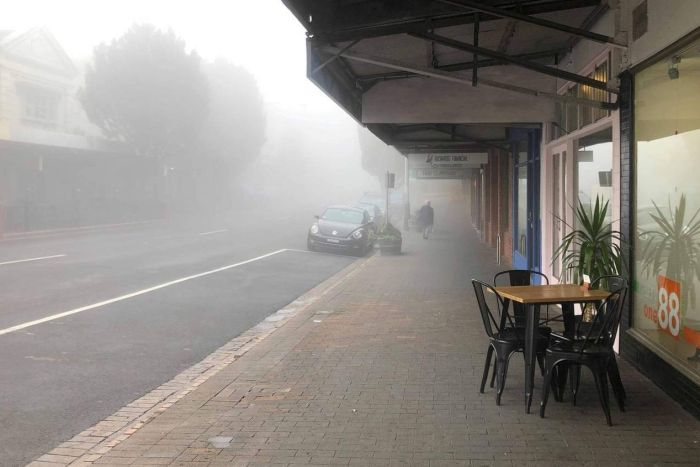 A street covered in mist