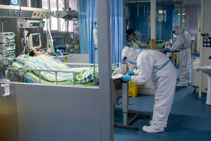 A medical worker attends to a patient in the intensive care unit at Zhongnan Hospital of Wuhan University.