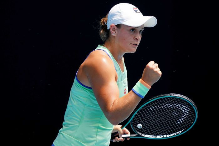 Ash Barty looks into the crowd and clenches her right fist.