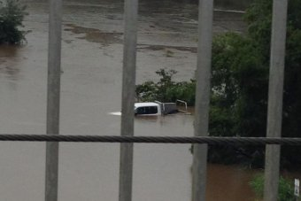 Car almost fully underwater