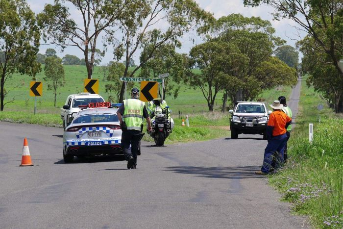 Police road block about two kilometres away from a property where an irrigation dam was leaking.