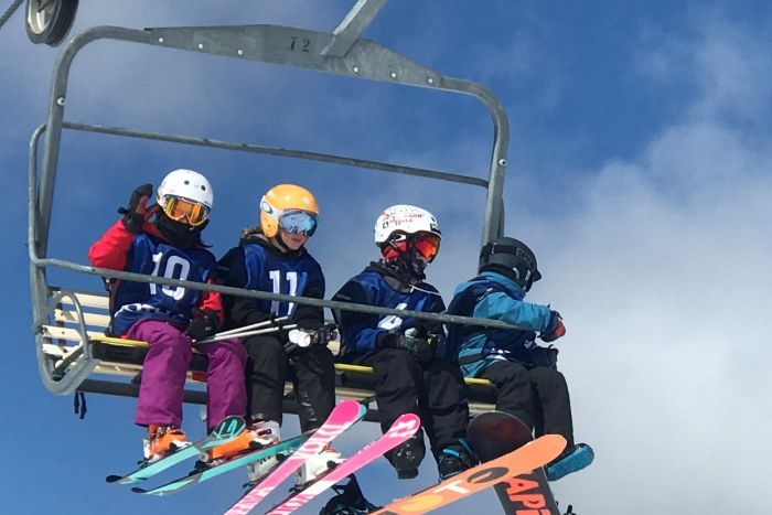 skiiers on a chairlift