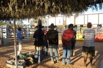 Aboriginal cowboys and locals look on at a rodeo at Doomadgee