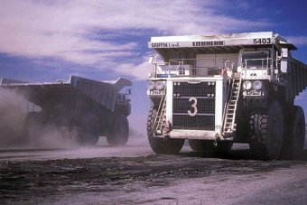 Mining trucks go about their work in the coal mine at Collie in Western Australia, December 2009.