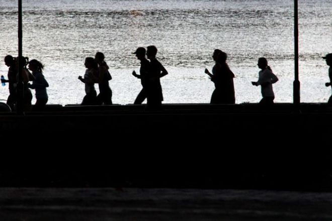 People jog during early morning exercise session.